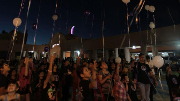 Some 50 children release balloons to honor children affected by domestic violence during the Awareness Walk and Hope in the Park held Thursday in El Centro.