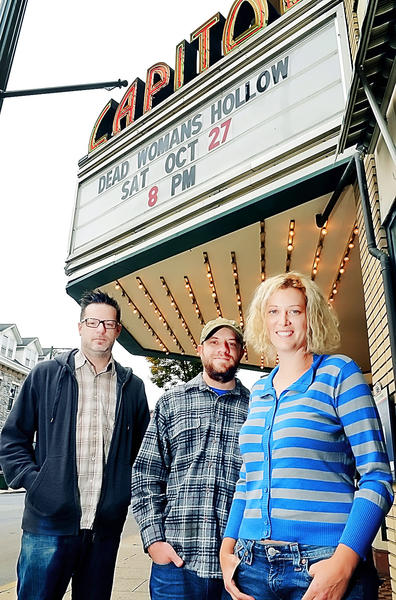 "From left, music composer Kevin Yost, director of photography Matt Stahley and director Libby McDermott stand in front of the Capitol Theatre in Chambersburg, Pa., where the movie ""Dead Woman's Hollow"" will premiere Saturday night."