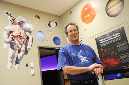 Dr. Joel Goodman, a dentist who is also an amateur astronomer, was recently named Howard County Volunteer of the Year for the time he's dedicated at the Robinson Nature Center. Goodman is pictured at the entrance of the nature center's planetarium.