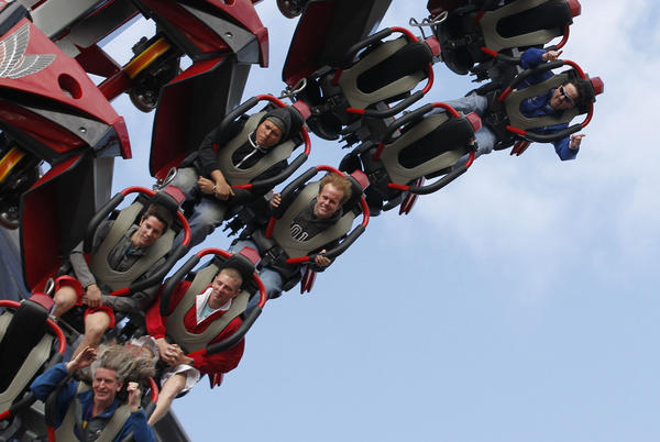 "Tony Kazian, upper right, professional wing-walker from Harvard, Illinois, rides the ""X-Fight"" roller coaster Wednesday, May 9, 2012 at Six Flags Great America."