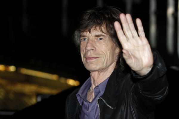 Mick Jagger arrives outside La Trabendo rock club in Paris for Rolling Stones' surprise show.