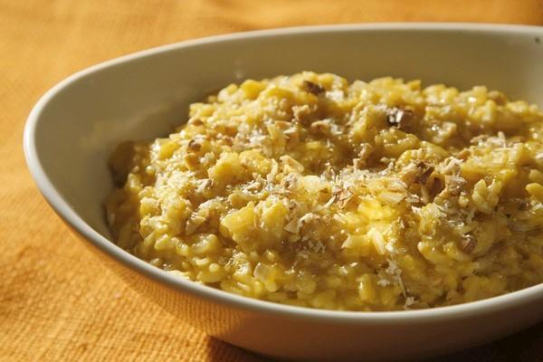 "Creamy pumpkin risotto is flavored with fresh rosemary and toasted walnuts. <a href=""http://www.latimes.com/features/food/la-fo-pressurecookersrec3-20111208,0,2999835.story"">Click here for the recipe.</a>"