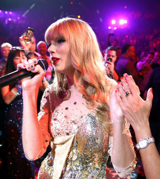 Why Taylor Swift rocks our world: ... but she manages to weather them with grace, like she did when her sparkly dress fell apart during the iHeartRadio Music Festival in Las Vegas.