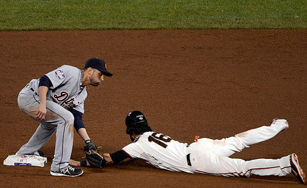 Giants Angel Pagan slides in ahead of Tigers Omar Infante's tag during Game 2 of the World Series on Oct. 25.