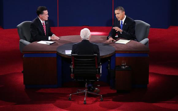 President Barack Obama debates with Republican candidate Mitt Romney as  Bob Schieffer of CBS looks on in Boca Raton, Fla.