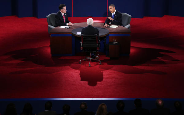 President Barack Obama debates with Republican candidate Mitt Romney as  Bob Schieffer of CBS looks on in Boca Raton, Fla.