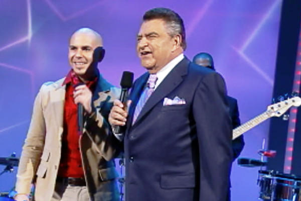 "Miami-based rapper and pop star Pitbull with Don Francisco on ""Sábado Gigante"" in 2010."
