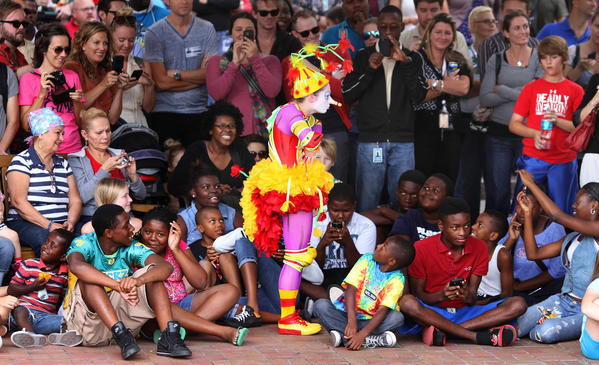 "Kids react to ""The Green Bird"", one of the stars of Cirque du Soleil's La Nouba show, performing a free lunchtime show on the plaza in front of Orlando City Hall, sponsored by the Creative City Project, Friday, October 26, 2012."