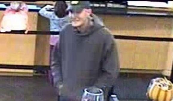 A surveillance photo of a man who robbed a Rolling Meadows bank this afternoon. FBI photo