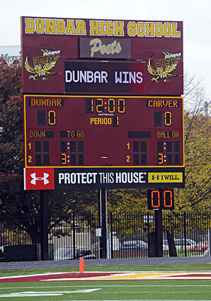 The new scoreboard at Dunbar's football stadium is demonstrated during a news conference.