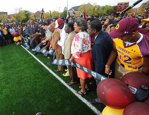Dunbar, Under Armour and Baltimore City officials cut the ribbon for the new stadium.