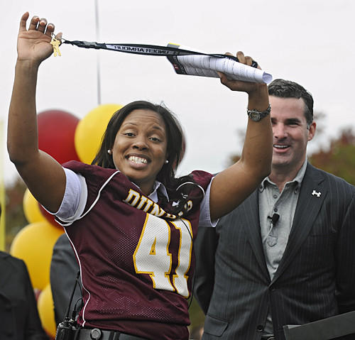 Dunbar principal Kristina Kyles, left, shows off the keys to the new stadium after Under Armour's Kevin Plank, background, presented them to her.