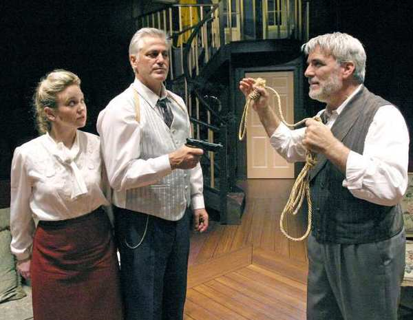 "Lydia Woods as ""Vera Claythorne""; Thor Edgell as ""Philip Lombard""; and Paul Nieman as ""Sir Lawrence Wargrave"" in the Glendale Centre Theatre's production of Agatha Christie's ""And Then There Were None."""