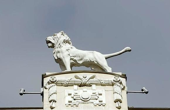 A sculpture of a lion on the top of the Art Nouveau building is pictured in Riga