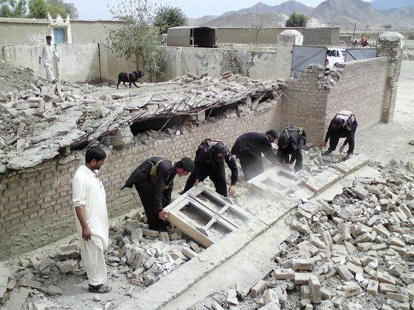 Pakistani security officials inspect the site of a bombing that targeted a primary school in Prata Kalay village. Human Rights Watch says 96 schools have been damaged or destroyed by Pakistani militants this year, a rate of more than two per week.