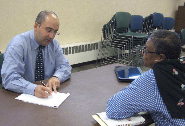 tanford Gann Jr., (left) a Towson-based attorney and chairman of the Baltimore County Bar Association pro bono committee, counsels Vivian Jefferson (right) of Woodlaw on Oct. 20 on a housing matter at the Pro Bono Day in Randallstown. A second Pro Bono Day will be held from 10 a.m. to 2 p.m. Saturday.