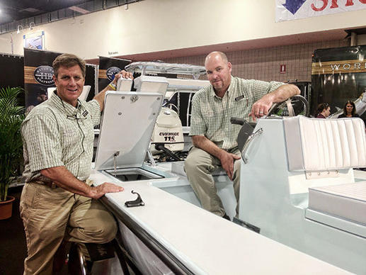 Chris Peterson, left, and Todd Fuller of Hell's Bay Boatworks show off one of the new hatches that opens to the rear of the re-designed Marquesa flats skiff.