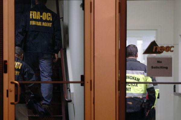 Federal agents search New England Compounding Center in Framingham, Massachusetts October 16, 2012. The pharmaceutical compounding company is a producer of the steroid methylprednisolone acetate, which is a drug linked to a rare form of meningitis that has killed 25 people and sickened more than 338 others.