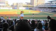 Mascot Muddonna entertains fans in between innings at Fifth Third Field during a Mud Hens minor league baseball game.