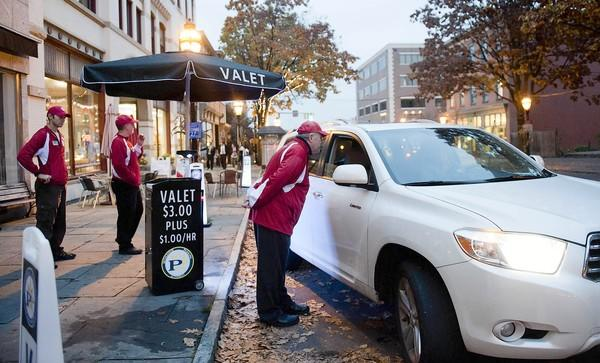 Sheppard Dweck offers valet parking to a visitor to Bethlehem's historic downtown. Valet parking is a new service offered by the Bethlehem Parking Authority.