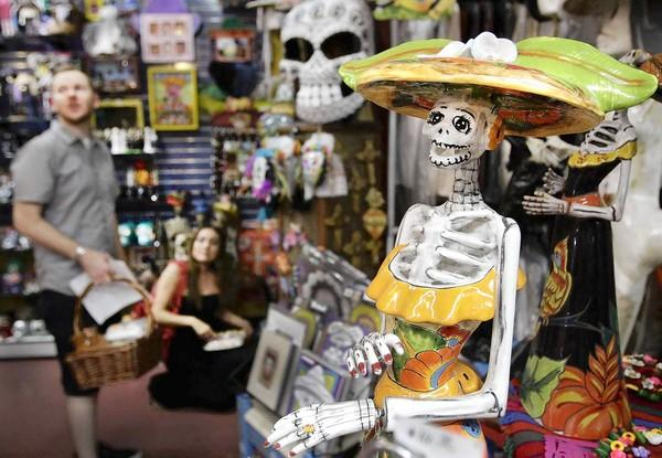A ceramic skeleton figure is among the Day of the Dead, or Dia de los Muertos, merchandise in Olverita's Village on Olvera Street in downtown Los Angeles.