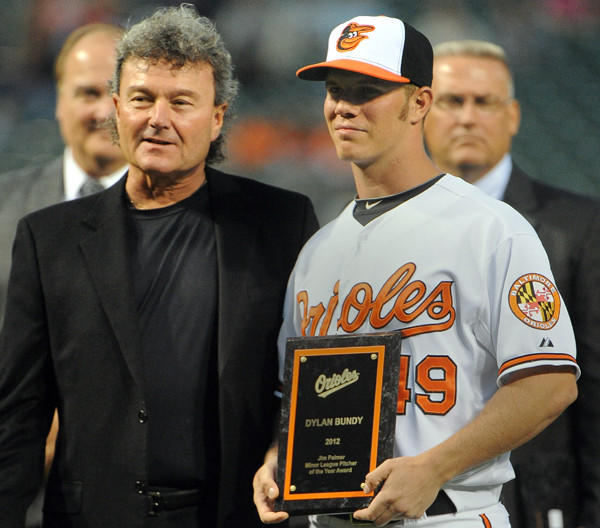 Rick Peterson, the Orioles' director of pitching development, poses with Dylan Bundy as Bundy was awarded the Jim Palmer award for the organization's minor league pitcher of the year.