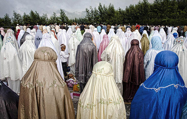 Indonesian Muslim women attend prayer at the slopes of Mount Merapi during celebrations for Eid al-Adha, the 'Festival of Sacrifice', at Kalitengah Lor village on October 26, 2012 in Yogyakarta, Indonesia. The three-day festival and holiday is celebrated by Muslims across the world as a commemoration of Abraham's willingness to sacrifice his son for God.