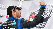 Jimmie Johnson's championship hopes got a boost Friday when he won the pole position for Sunday's NASCAR Sprint Cup race at Martinsville Speedway while points leader Brad Keselowski qualified 32nd.