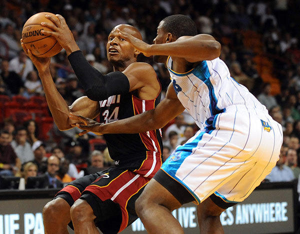 Ray Allen looks to pass as Darius Miller of the New Orleans Hornets defends on the play during a preseason game at the American Airlines Arena. Miami Heat vs. New Orleans Hornets.