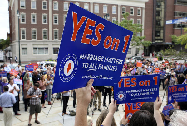 Gay marriage supporters gather at a rally outside of City Hall in Portland, Me. in support of an Nov. ballot question that seeks to legalize same-sex marriage. Maryland and Washington will also vote next month on allowing same-sex marriage.