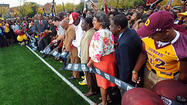 The crowds ringed the fence at Dunbar's re-done football field long before the start of the game Friday. Fans were calling the school six hours before kickoff trying to score tickets, and it sold out three hours early.