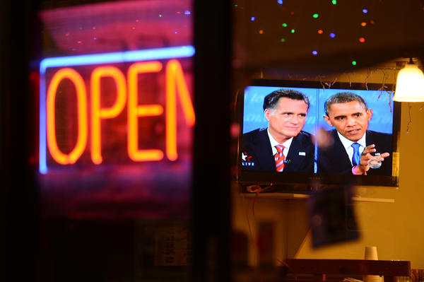 The debate between presidential debate between President Obama and Republican presidential candidate Mitt Romney is seen on a television in a Korean restaurant in Los Angeles.