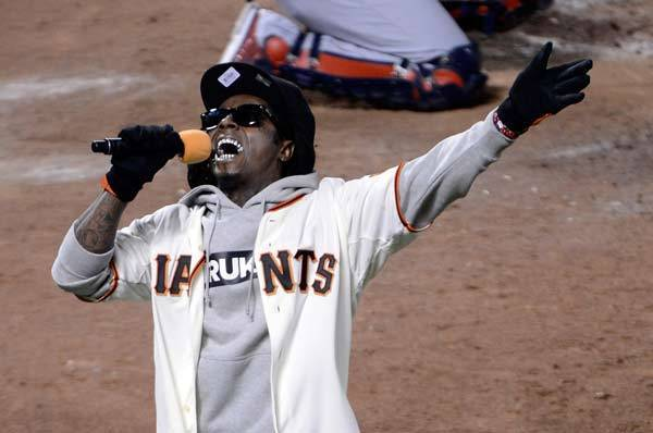 Rapper Lil Wayne sings 'Take Me Out to the Ball Game' during the seventh inning as the San Francisco Giants take on the St. Louis Cardinals in Game Six of the National League Championship Series.