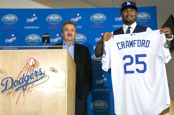 Dodgers General Manager Ned Colletti introduces Carl Crawford to the media on Friday at Dodger Stadium.
