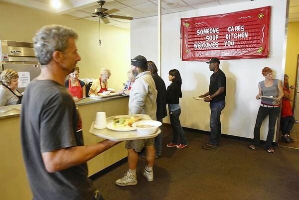 Guests arrive for an afternoon lunch at the Someone Cares Soup Kitchen, where the YOU Count homelessness survey is being conducted by Vanguard University and churches from Costa Mesa.
