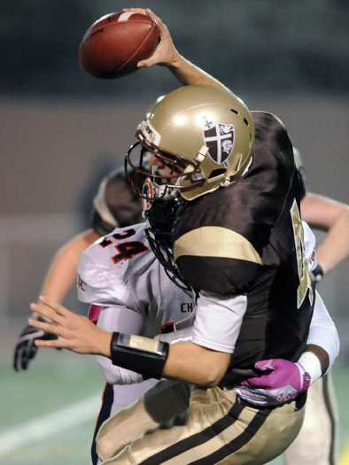 St. Francis quarterback Jared Lebowitz is sacked for a loss by Chaminade's Cory Harris.