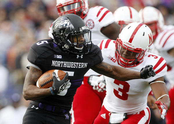 Northwestern Wildcats running back Venric Mark (5) runs past Nebraska Cornhuskers safety Daimion Stafford (3) during the first quarter at Ryan Field last Saturday.