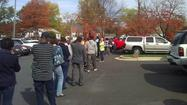 Hurricane Sandy contributes to long lines for early voting