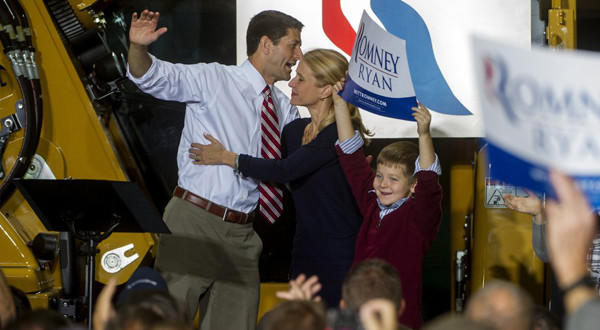 Republican vice presidential candidate Paul Ryan (R-Wis.) is greeted by his wife, Janna, and his son Charlie, holding a sign, after his campaign speech at the Gradall Industries plant in New Philadelphia, Ohio. Ryan is targeting women voters in the crucial swing state.