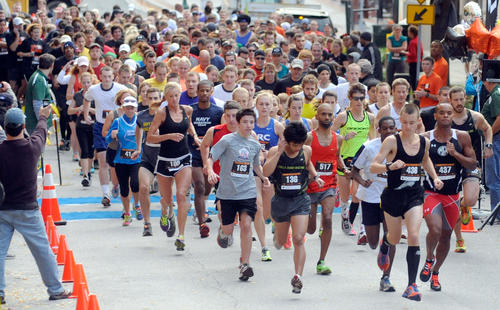 Runners begin the Towson Downtown 5k along W. Chesapeake Ave., Saturday, Oct. 27.