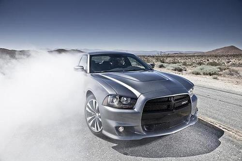 """Starting at an estimated price of $46,660, the Charger SRT8 boasts a top speed of 175 mph, 470 horsepower, a matching 470 foot-pounds of torque and a combined EPA fuel economy estimate of 17 miles per gallon. <br> <a href=""""http://www.latimes.com/business/la-fi-autos-dodge-charger-review-20110728,0,2327206.story""""><u>See full story</u></a>"""