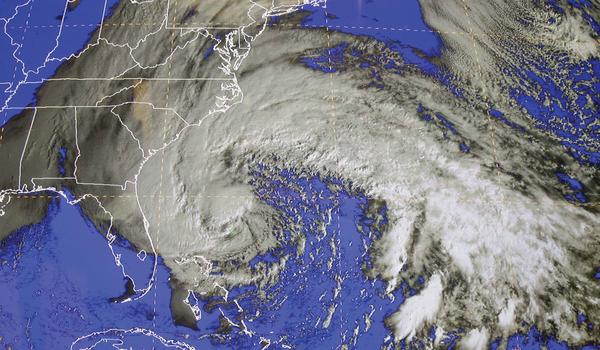 A satellite image of Sandy is shown at the National Hurricane Center in Miami, Saturday. Early Saturday, the storm was about 335 miles southeast of Charleston, S.C. Tropical storm warnings were issued for parts of Florida's East Coast, along with parts of coastal North and South Carolina and the Bahamas. Tropical storm watches were issued for coastal Georgia and parts of South Carolina, along with parts of Florida and Bermuda. Sandy is projected to hit the Atlantic Coast early Tuesday.