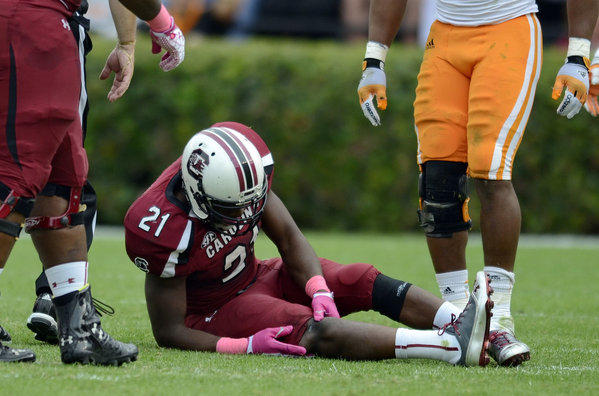 South Carolina running back Marcus Lattimore grabs his right knee after being hit by Tennessee's Eric Gordon during the first half Saturday.