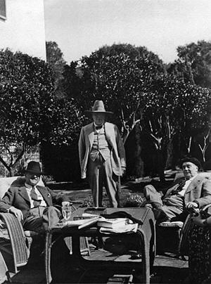 Somerset Maugham on the terrace with Winston Churchill and H.G. Wells.