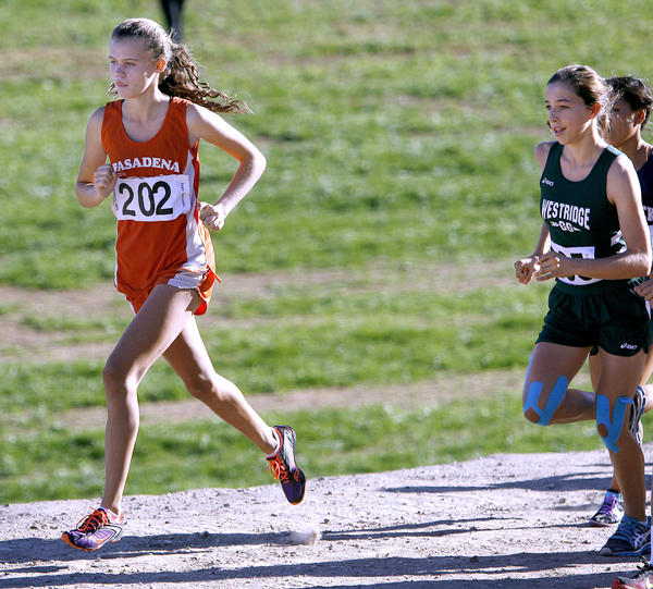Pasadena Poly's Evan Gancedo, left, kept the competition at bay to win the Prep League Girls Varsity Cross-Country race at Pierce College in Woodland Hills on Saturday, Oct. 27, 2012.  The Mayfield Senior School team won the girls league title.  Emma Hovanec, who finished second, from Westridge High, is at right.