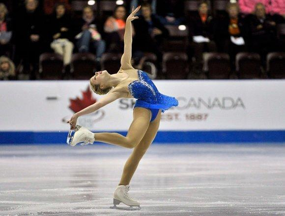 Gracie Gold spinning in Saturday's free skate at Skate Canada. (Mike Cassese / Reuters)