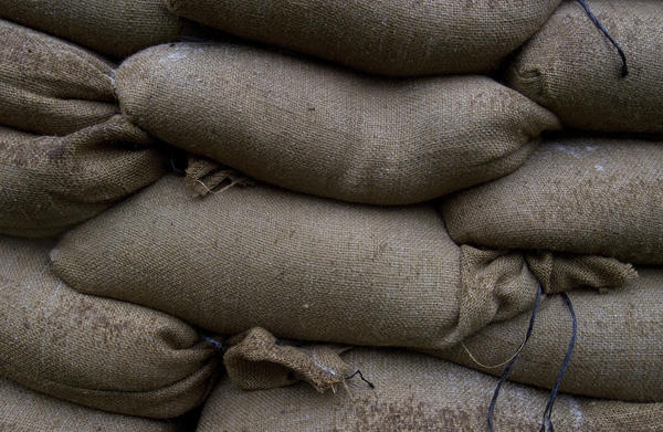 Sandbags sit stacked against a door of the Casemate Museum at Fort Monroe on Saturday as residents prepare for the effects of Hurricane Sandy.