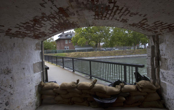 Sandbags line a gate to the interior of Fort Monroe on Saturday as residents prepare for the effects of Hurricane Sandy.