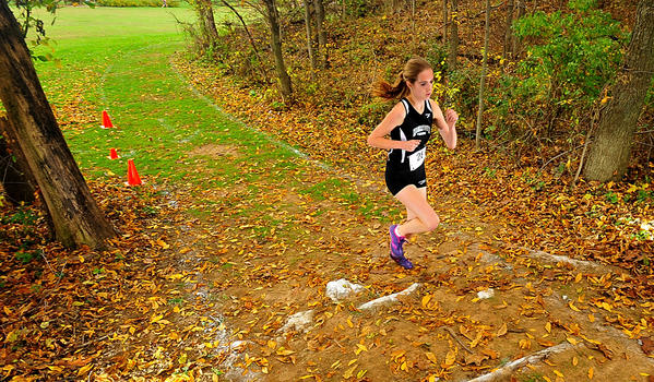 Hagerstown's Casey Barr heads into the woods alone in first place Saturday during the Maryland JuCo/Region XX Cross Country championships. She won the women's race at Washington County Regional Park.