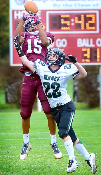 Saint James receiver Kyle Neale (15) could not come down with the ball while being covered by Maret's Philip Gieger during Saturday's prep football game.